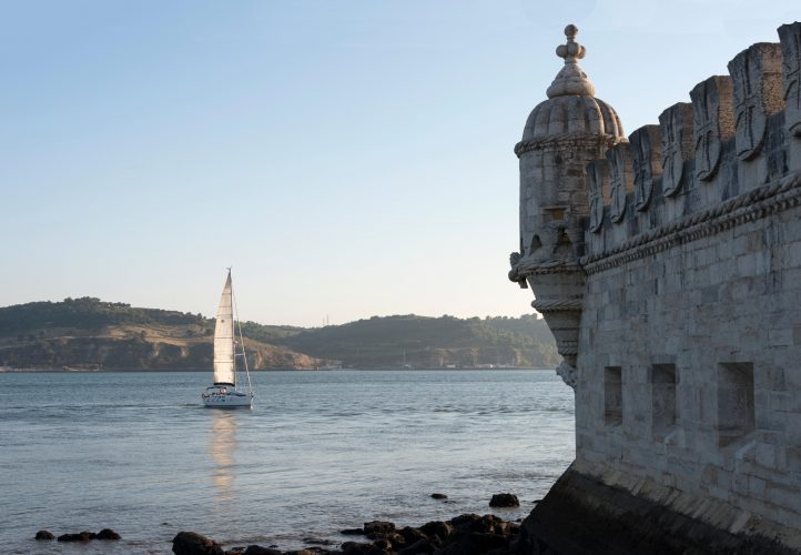 Ship sailing on the Tagus river in front of the Belem tower in Lisbon