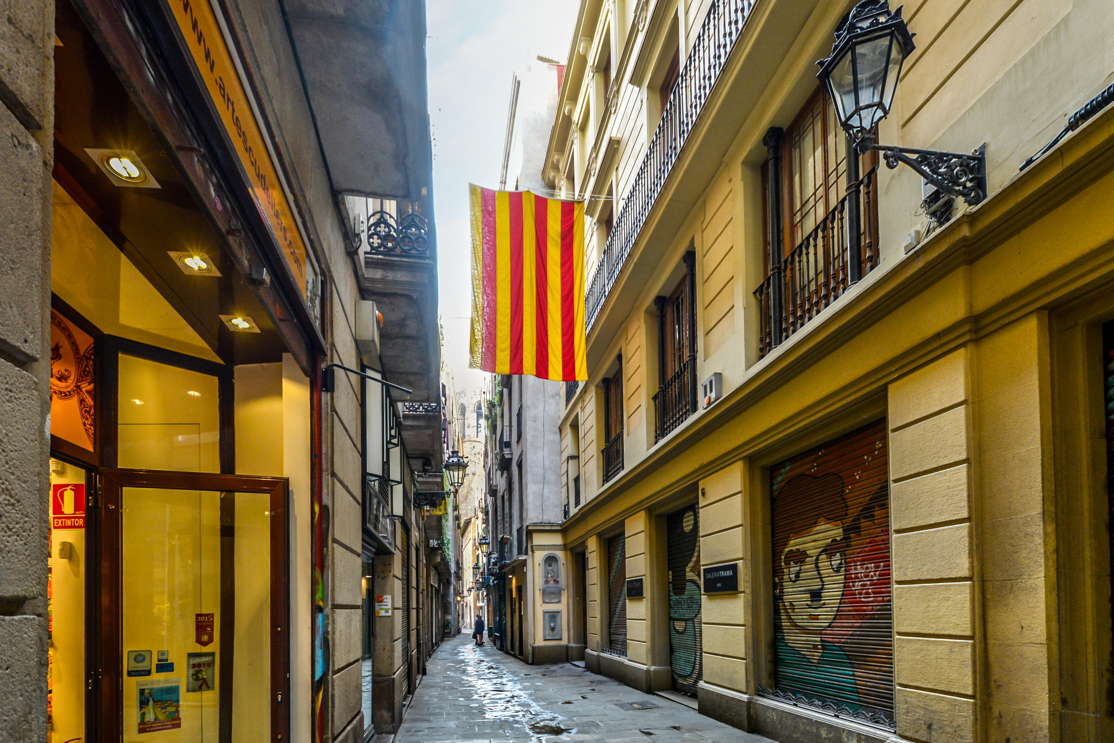 The yellow and red striped Catalan flag flies from a balcony in the gothic quarter of Barcelona Spain