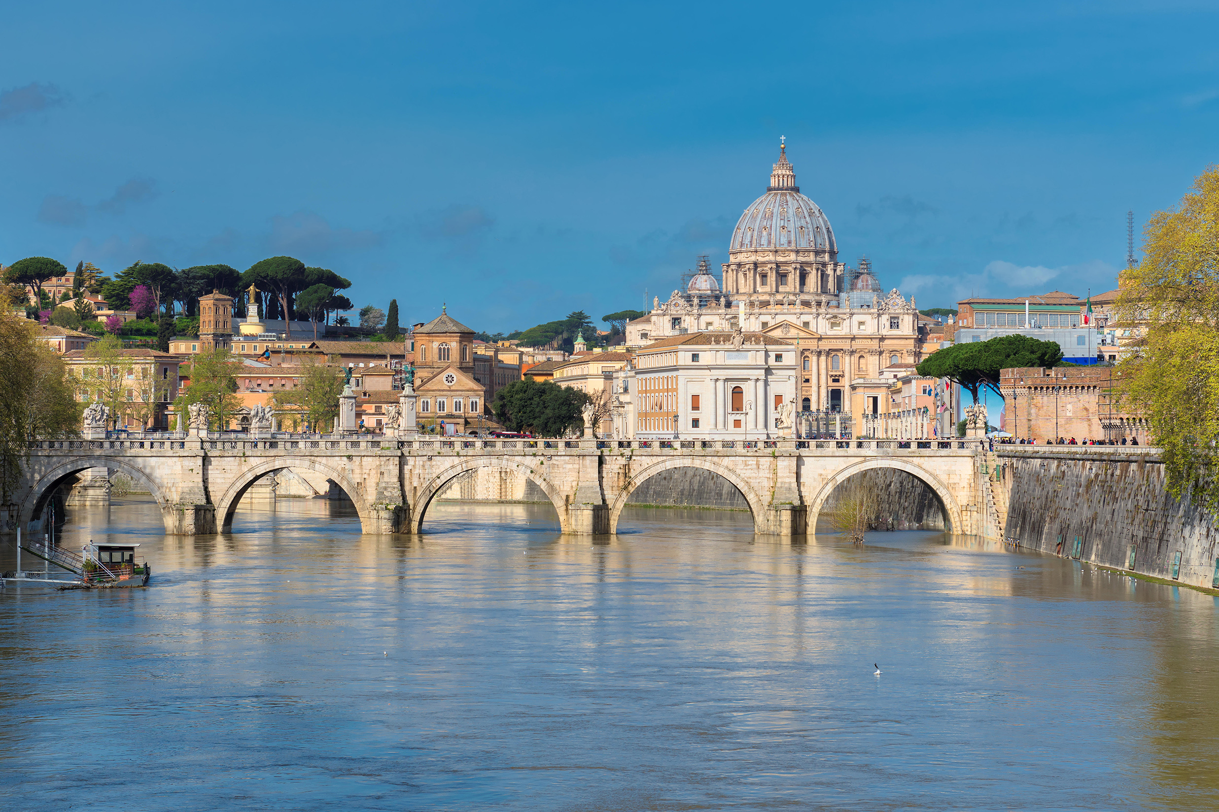 Beautiful view of St. Peter's cathedral with bridge in Vatican, Rome, Italy.