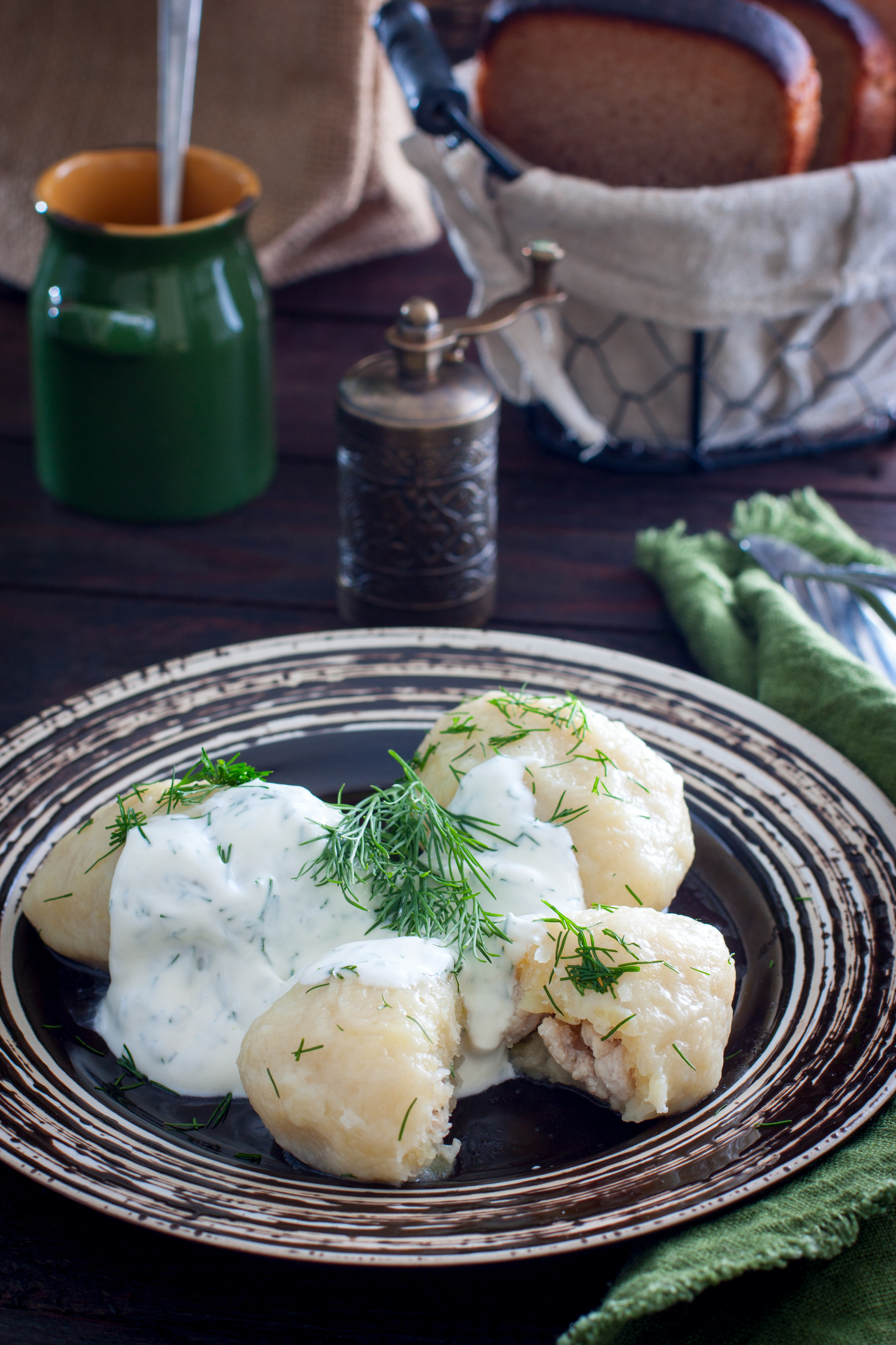 Traditional Lithuanian dish meal cuisine - stuffed meat potato dumpling (Cepelinai,didzkukuliai),most popular Lithuanian national dish, curd, similar to polish