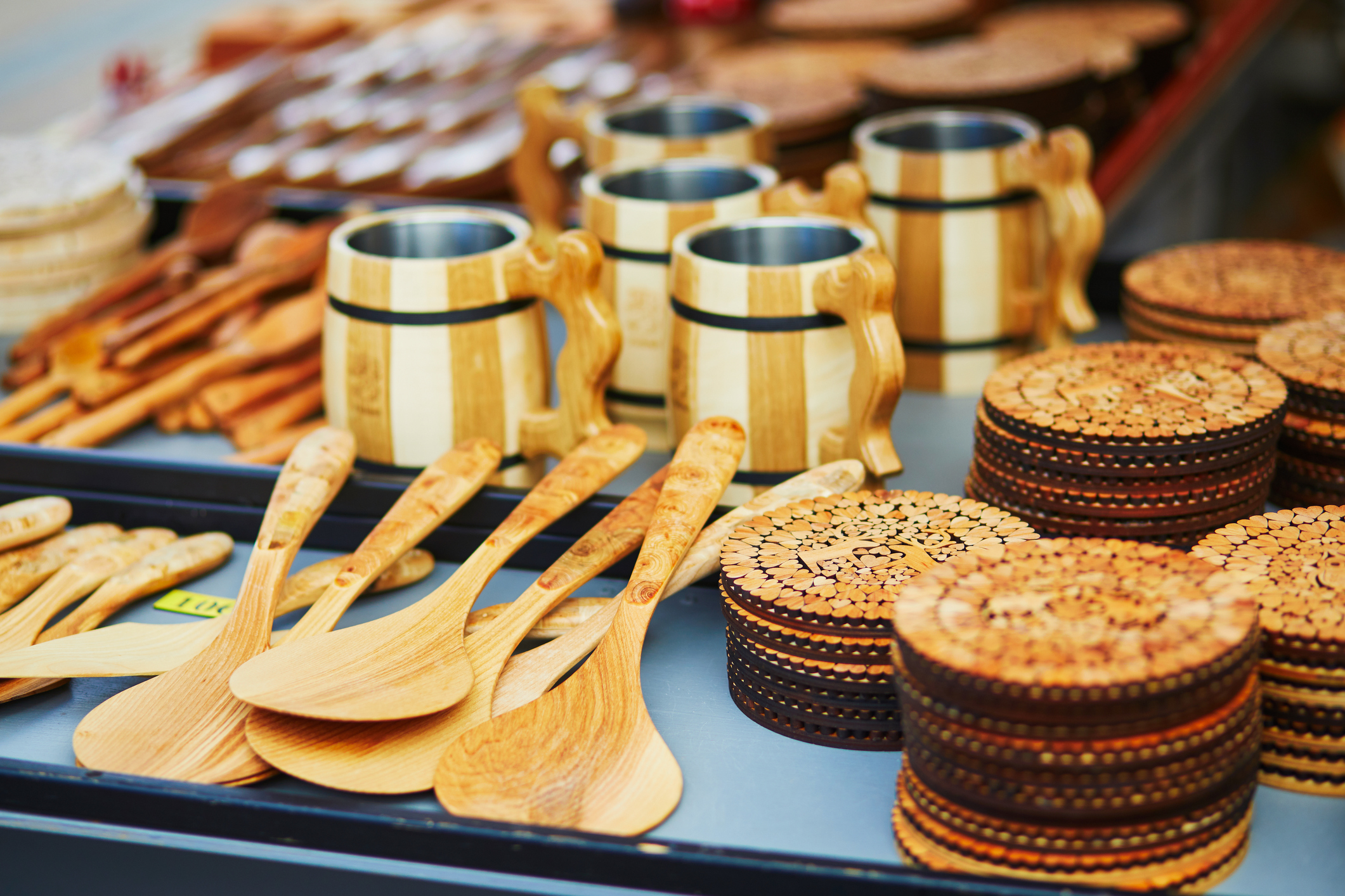 Traditional Finnish wooden beer cups on market