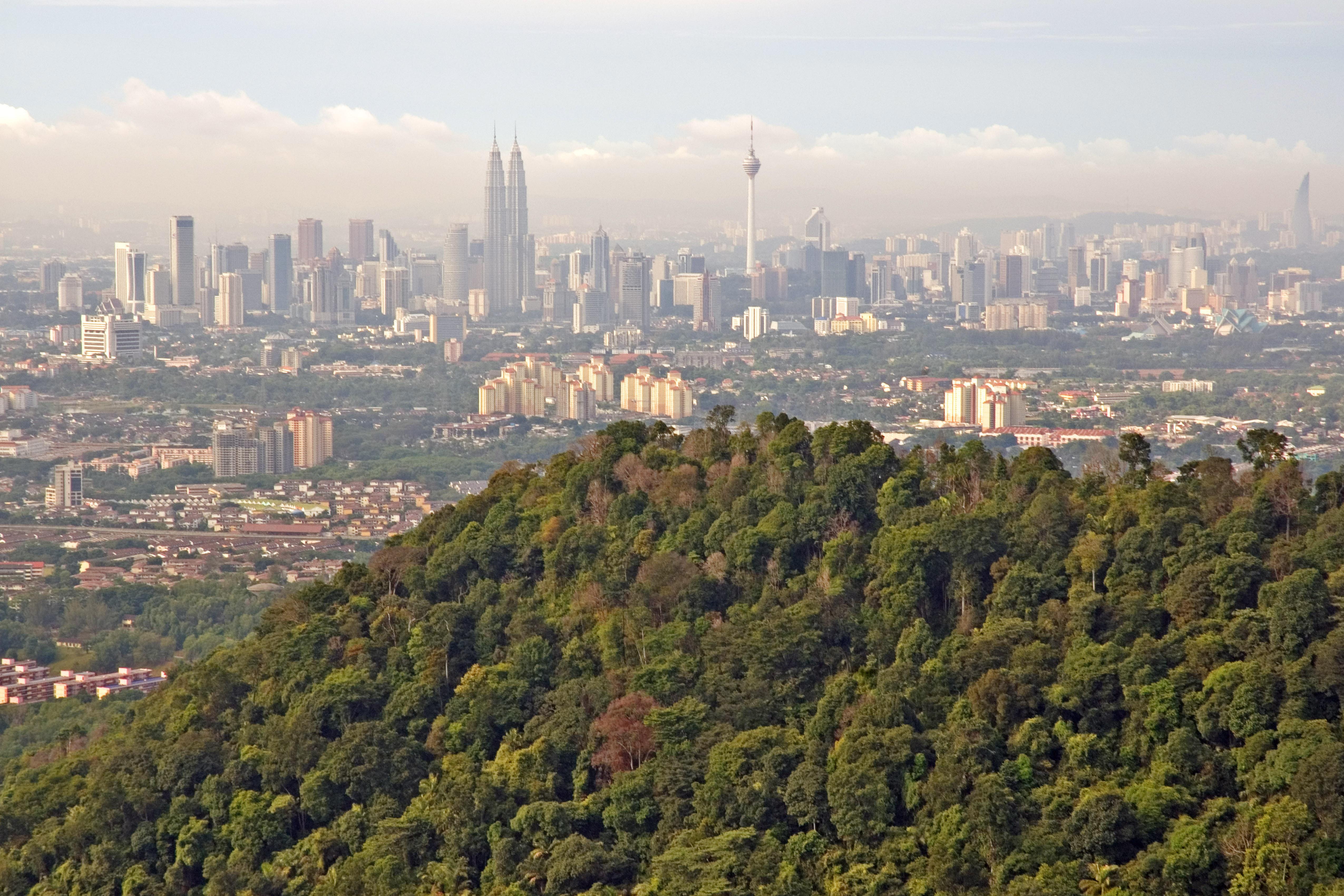 Natural vs Concrete Jungle a view of Kuala Lumpur from Bukit Tabur quartz ridge