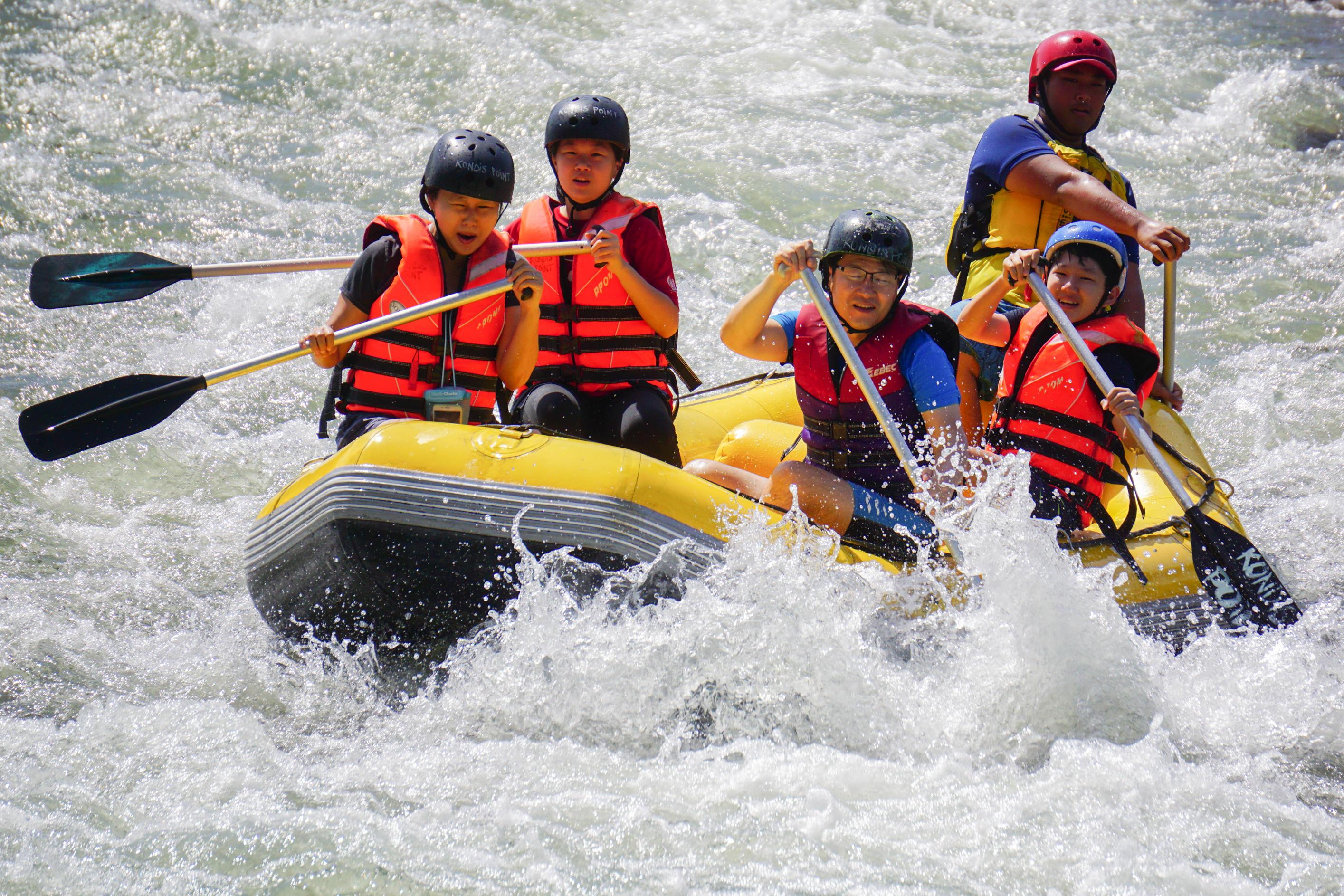 Kiulu Sabah Malaysia - Nov 4, 2018 : Group of adventurer doing white water rafting activity at Kiulu river Sabah Malaysian Borneo on Nov 4, 2018.The r