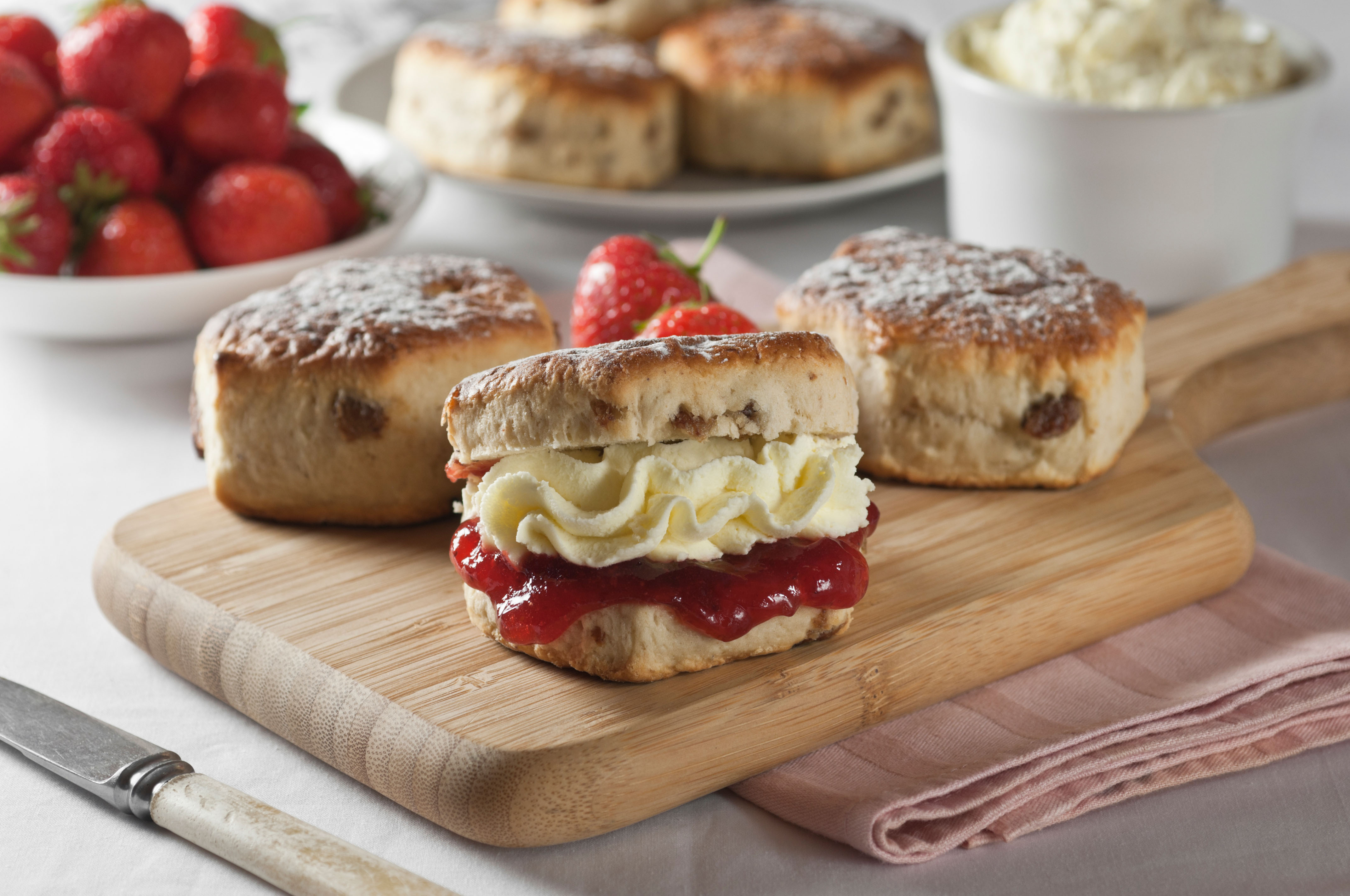 Traditional English scones with strawberry jam and cream