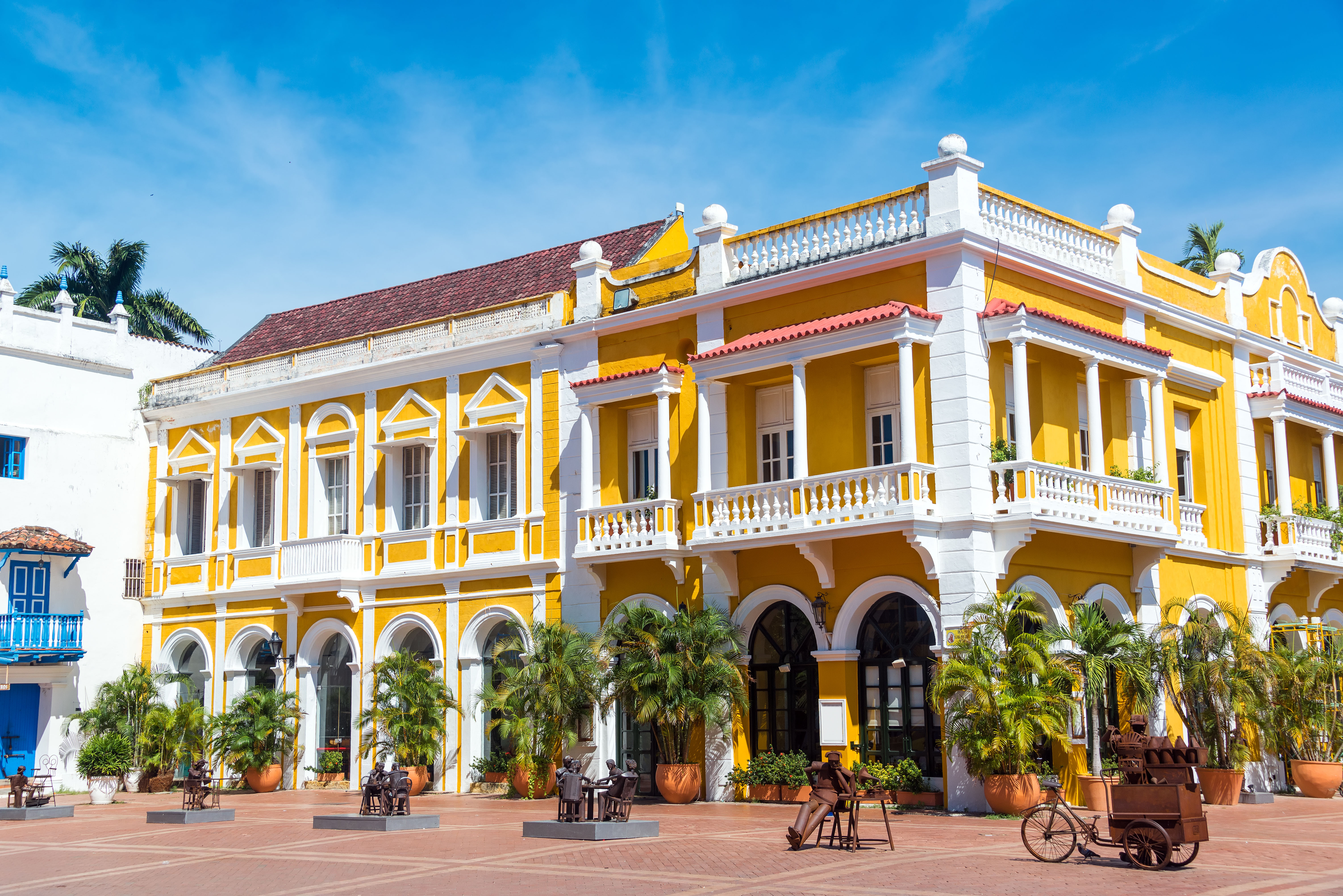 Yellow and white colonial building the historic center of Cartagena, Colombia