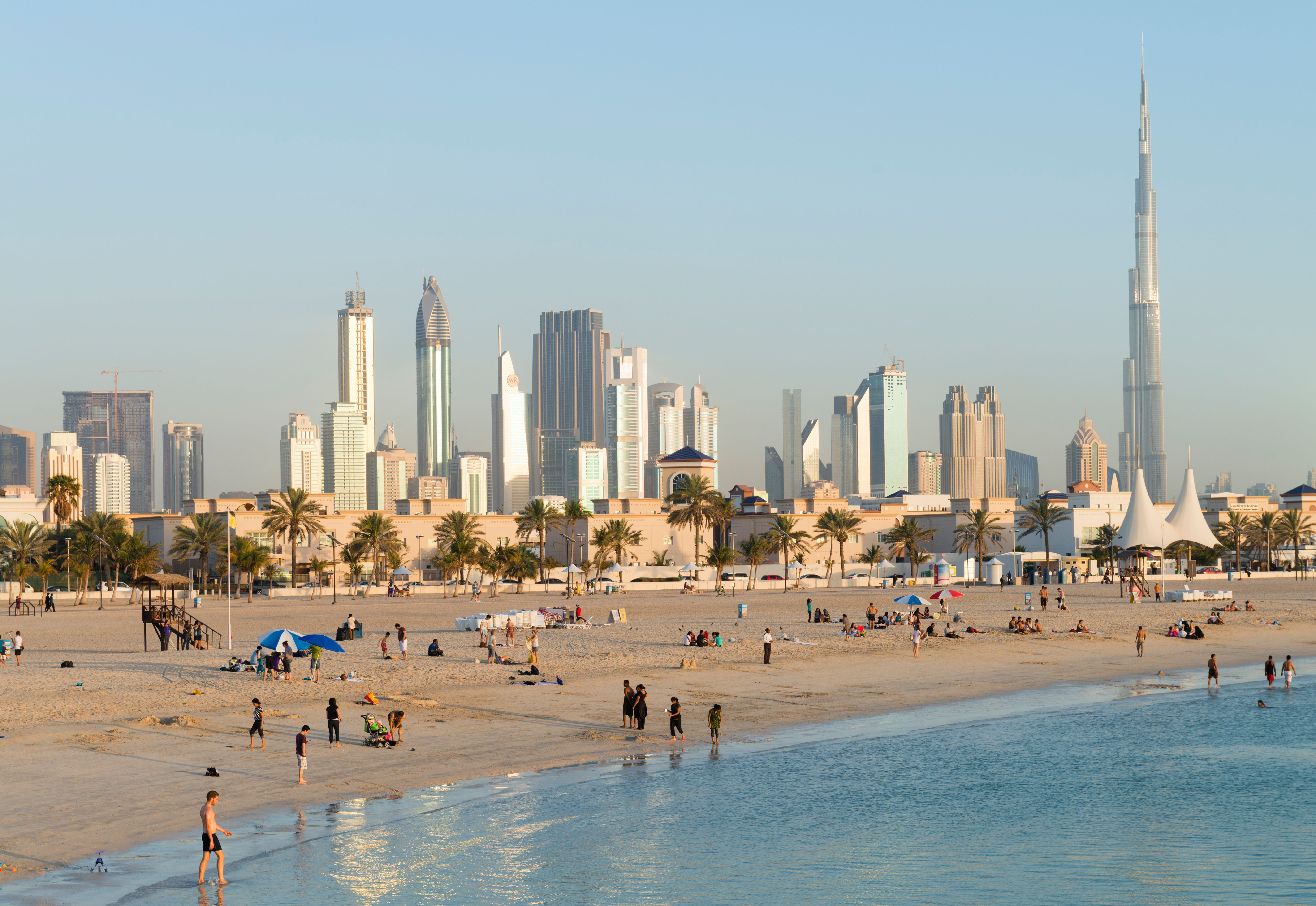 View of modern skyline of Dubai from Jumeirah Open Public Beach in United Arab Emirates UAE