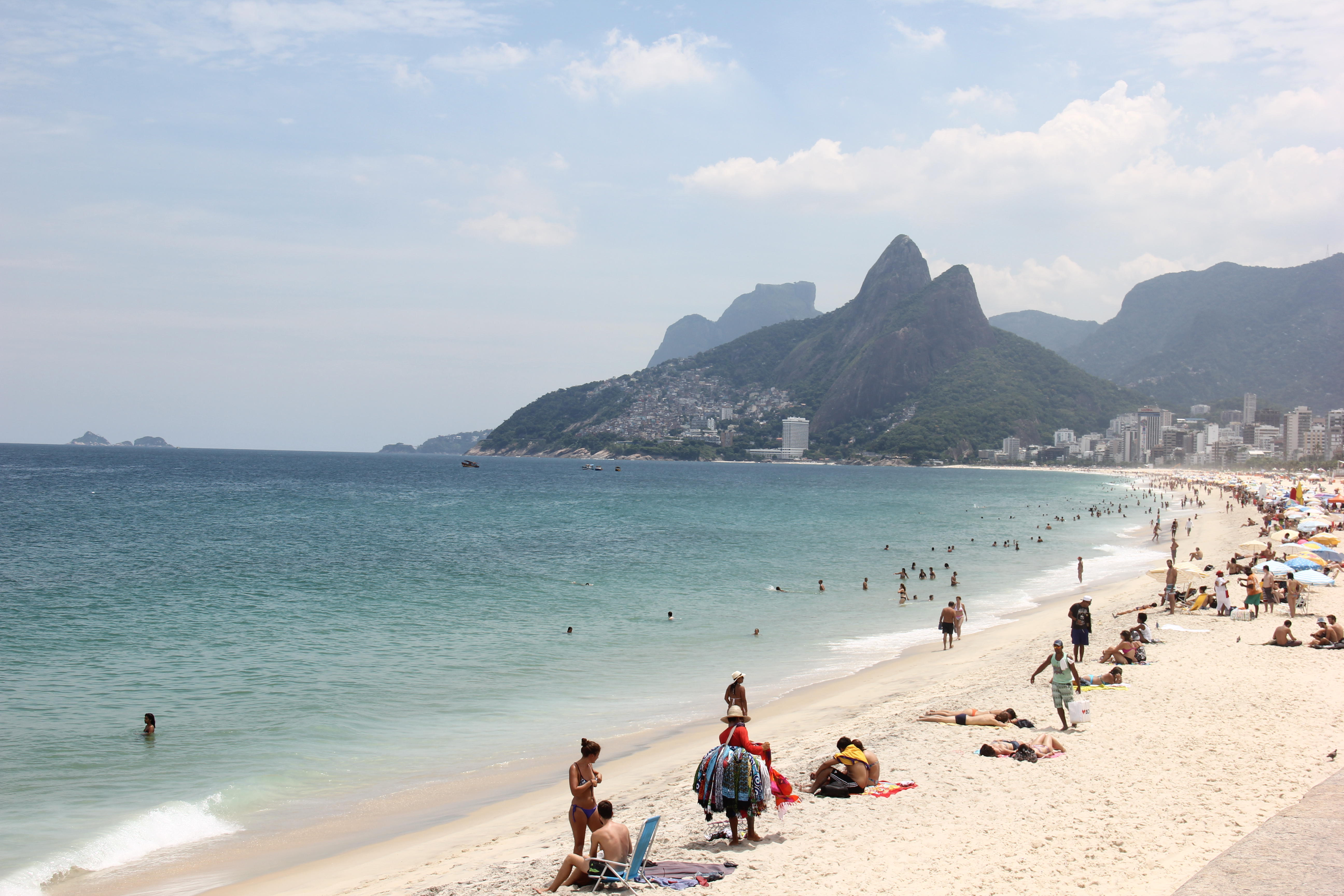 Rio de Janeiro, Brazil, 24 February 2016: With the strong heat, passing the 35 degrees celsius, locals and tourists enjoying the the Southern Rio beaches even during weekdays. View of Ipanema and Leblon beaches that were in the clear and calm waters on th