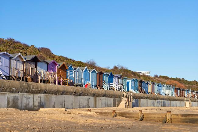 Multi-coloured beach huts add a pop of colour to Frinton-on-Sea's beachfront