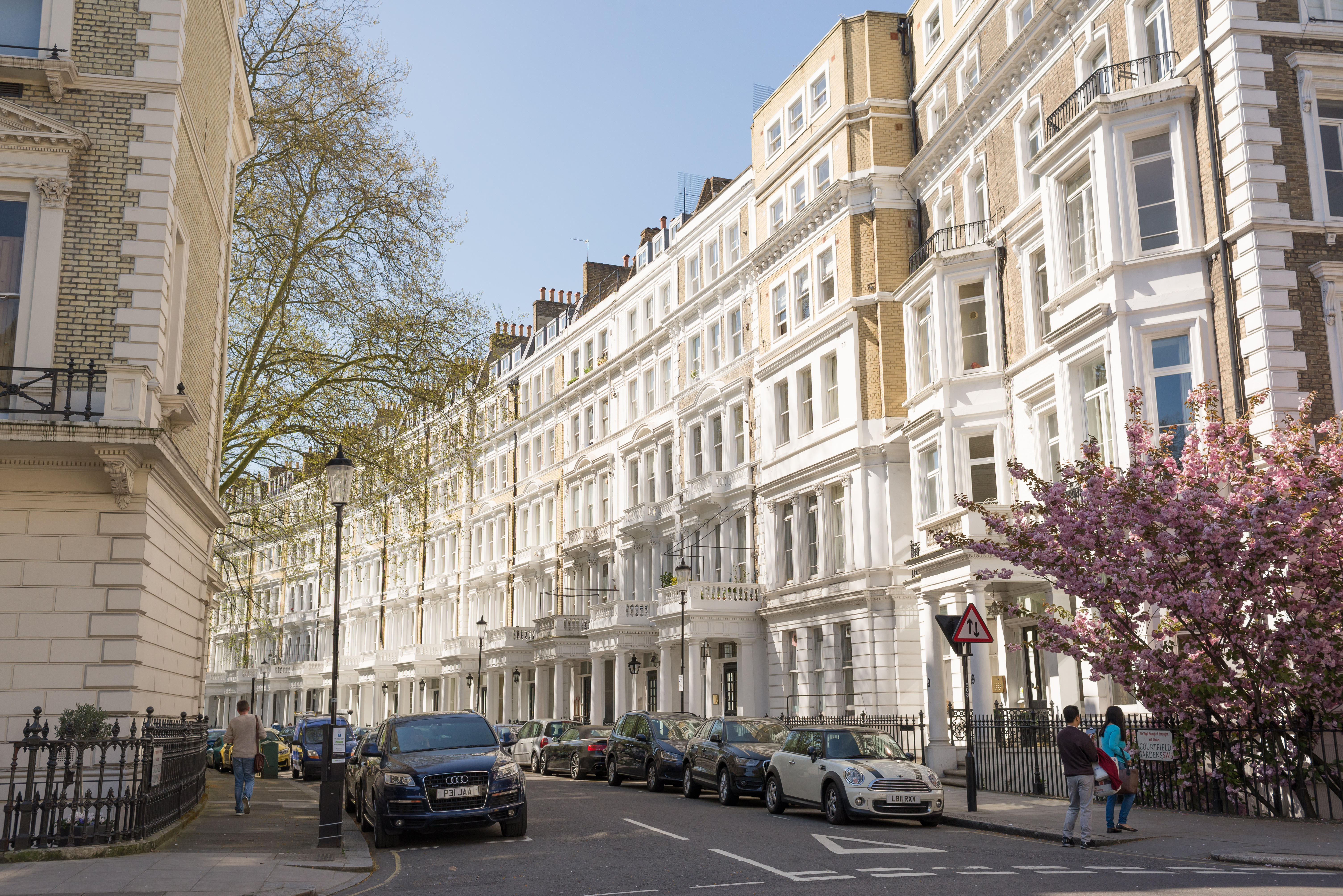 View of street with restored elegant Victorian Edwardian luxury houses in the exclusive area of South Kensington, London, UK