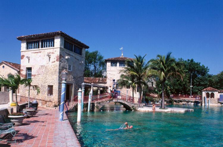 USA, Florida, Miami, Coral Gables, visitor swimming in Venetian Pool