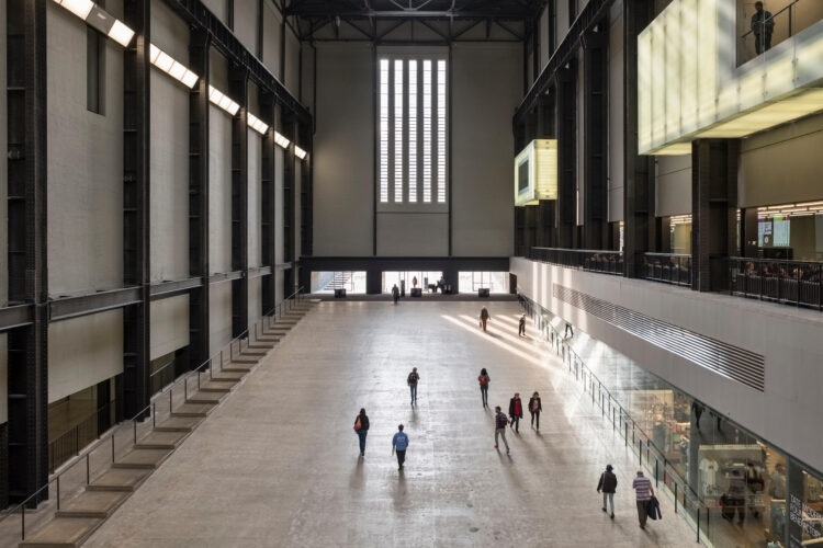 Visitors on the entrance ramp to the the vast Turbine Hall at Tate Modern, Bankside, London, UK