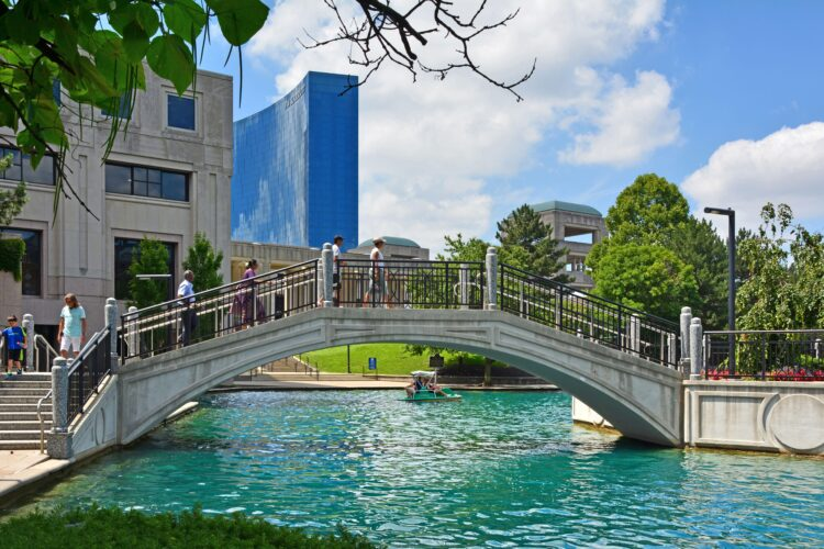 Indianapolis IN, USA 06- 30-18 Downtown Indy Canal Walk has about 3 water miles for the enjoyment of pedal boats, bicycles, gondolas and even Segways